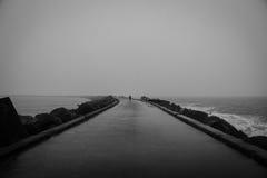 Moody walk on the pier  Stock Image