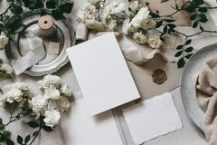 Free Moody Wedding Table Mockup Scene. Feminine Desktop Composition With Fading White Rose Flowers, Silver Plate, Silk Royalty Free Stock Photo - 169159385