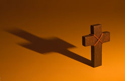 Moody wooden cross casting long shadow Royalty Free Stock Photography