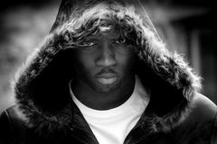 Portrait of Moody Young Black Man. Moody Young Black Man wearing a Fur Hood Royalty Free Stock Image