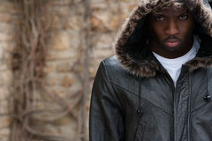 Portrait of Moody Young Black Man. Moody Young Black Man wearing a Fur Hood Royalty Free Stock Photography