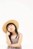 Het mooie Aziatische meisje denken Royalty-vrije Stock Afbeeldingen