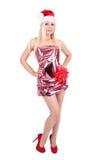 Mooi blonde meisje in de hoed van de Kerstman en glanzende kleding Royalty-vrije Stock Afbeelding
