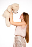 Mooi blonde meisje met teddybeer Royalty-vrije Stock Foto