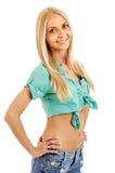 Mooi blondemeisje dat de camera en het glimlachen onderzoekt Royalty-vrije Stock Afbeeldingen