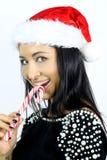 Mooi brunette met een suikergoedriet Stock Fotografie