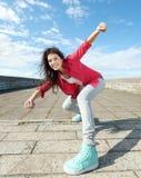 Mooi dansend meisje in beweging Royalty-vrije Stock Foto's