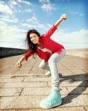 Mooi dansend meisje in beweging Stock Afbeeldingen