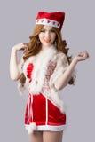 Mooi de vrouwenmodel van Azië in Santa Claus-kleren stock afbeelding