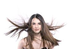 Mooi donkerbruin meisje met winderig haar Stock Foto's