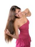 Mooi donkerbruin meisje in roze kleding Royalty-vrije Stock Foto's