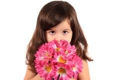 Mooi drie éénjarigenmeisje met bloemen Royalty-vrije Stock Afbeelding