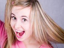 Mooi en gelukkig meisje met lang haar Stock Fotografie