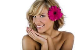 Mooi en modieus meisje met bloem in het haar op wit stock afbeeldingen