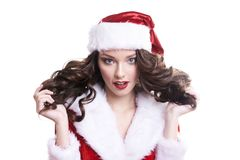 Mooi gelukkig jong Kerstmanmeisje op witte achtergrond Royalty-vrije Stock Afbeelding
