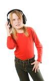 Mooi gelukkig meisje met hoofdtelefoons royalty-vrije stock afbeelding
