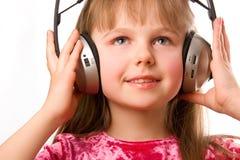 Mooi gelukkig meisje met hoofdtelefoons Stock Afbeeldingen