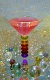 Mooi glas met drank met meloen en strawberrys stock afbeelding