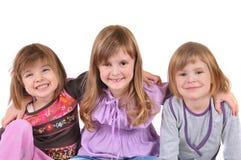 Mooi glimlachend meisje drie op witte achtergrond stock fotografie