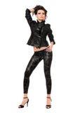 Mooi jong brunette in zwarte kleren. Geïsoleerd royalty-vrije stock afbeeldingen