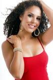 Mooi jong donkerbruin wijfje in rode kleding royalty-vrije stock afbeelding