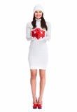 Mooi jong Kerstmismeisje met een heden. Royalty-vrije Stock Afbeeldingen