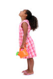 Mooi Jong Meisje dat met de Gieter van de Bloem omhoog kijkt stock afbeelding