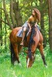 Mooi jong meisje op paard Stock Afbeelding