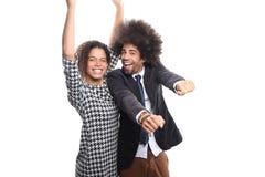 Mooi liefdepaar voor een witte achtergrond die uitdrukkingen doen royalty-vrije stock foto