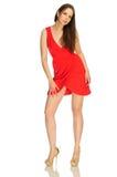 Mooi meisje bij rode kleding Stock Afbeelding