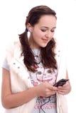 Mooi meisje dat aan muziek luistert Stock Foto