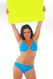 Mooi meisje dat helder teken houdt Stock Foto's
