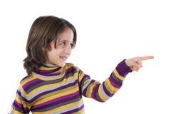 Mooi meisje dat met haar vinger richt Stock Afbeeldingen