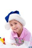 Mooi meisje in de hoed van de Kerstman Stock Foto's