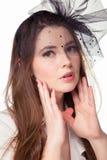 Mooi meisje in een hoed stock afbeelding
