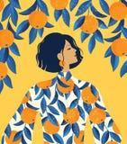 Mooi meisje in een kleding met de druk van het sinaasappelenpatroon en een oranje boomachtergrond royalty-vrije stock afbeeldingen