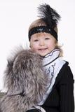Mooi meisje in een kleding zitting en het glimlachen Stock Afbeelding