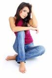 Mooi meisje in jeans stock afbeelding