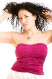 Mooi meisje in magenta bovenkant Royalty-vrije Stock Afbeeldingen