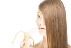 Mooi meisje met banaan dat op wit wordt geïsoleerde. Royalty-vrije Stock Afbeelding