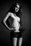 Mooi meisje met camera Royalty-vrije Stock Afbeeldingen