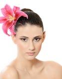 Mooi meisje met een bloem Royalty-vrije Stock Foto's