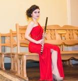 Mooi meisje met een fluit stock afbeeldingen