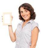 Mooi meisje met een fotoframe Stock Afbeeldingen