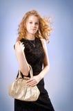 Mooi meisje met een handtas Stock Foto's
