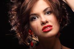 Mooi meisje met een litteken op gezicht en schouder Stock Foto