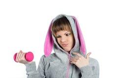 Mooi meisje met een roze domoor Stock Foto's