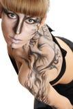 Mooi meisje met een verf op haar huid Royalty-vrije Stock Afbeelding
