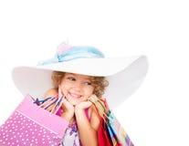 Mooi meisje met gekleurde zakken Stock Afbeeldingen