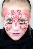 Mooi meisje met gezichtsverf Stock Afbeelding